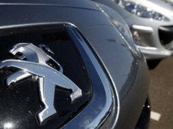 The Peugeot logo is seen at a dealership of French car maker PSA Peugeot-Citroen in Selestat