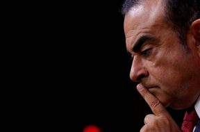 FILE PHOTO – Carlos Ghosn, Chairman and CEO of the Renault-Nissan Alliance, reacts during a news conference in Paris