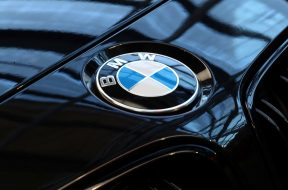 FILE PHOTO: A logo of German luxury carmaker BMW, is seen ahead of the company's annual news conference in Munich